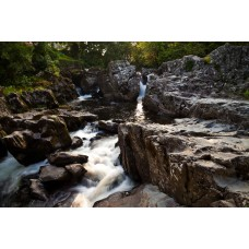 Betws y Coed waterfall in the setting sun